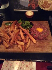 Beef tartare--yep, that's raw, chopped beef mixed with things like capers and other tasty ingredients, served with a raw egg in the center and fries at La Balancoire in Montmartre. I devoured every morsel.